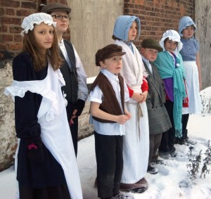 Children from Martin Wilson School re-enacting as Flaxmill apprentices