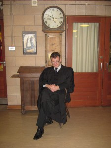 Head Teacher of the Martin Wilson School, David Purslow, with the clock and Head's chair and lectern from the old Lancasterian School