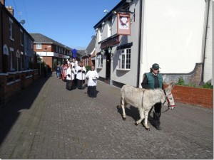 Palm Sunday procession to All Saints Church led by Hannah the donkey