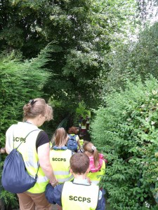 Children from the Shrewsbury Cathedral Catholic School on a 'know your local area' history walk going down the steps by the prison to the river